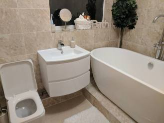Marvel Plumbing Services Bathroom with TV 2